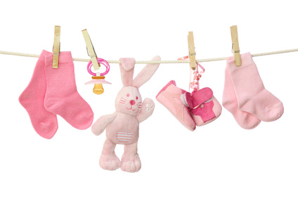 Pink baby goods hanging on the clothesline