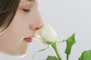 profile of a girl holding white rose